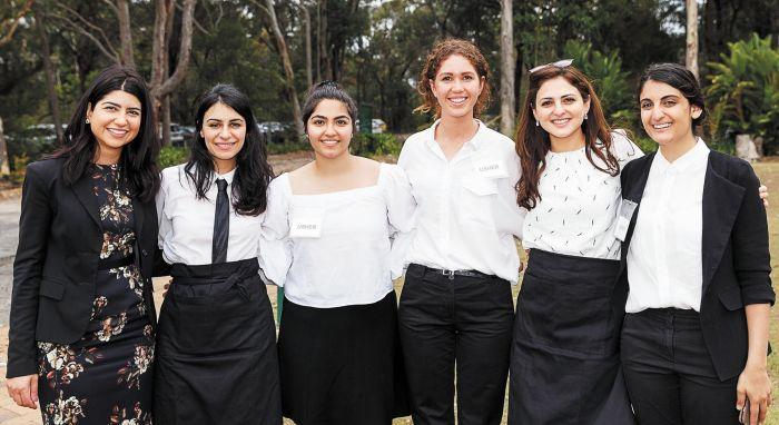 (L-R): Geeti Faramarzi, Mona Forghani, Niyousha Balouchgharaei, Sarah Fanayan, Boshra Awan and Awa Momtazian, volunteering at the Bahá'í House of Worship, during the bicentenary celebrations in October. Photo: QJ Oh