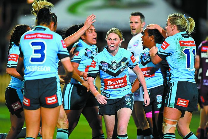 Captain Maddie Studdon (centre) with the victorious Women's NSW Blues. Photo: NRL Photos